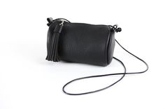 """The Mini Cylinder is a lovely way to carry what you need for the day. It's  a perfect fit for your phone, keys, makeup, etc. Comes with detachable  tassel. Made in soft pebble grain leather. Available in Onyx Black, Deep  Wine, Sienna Brown, and Natural.  Dimensions: 8""""W x 4.5"""" Diameter  Construction: This is completely hand-cut and hand-stitched. All the  stitching is double needle saddle stitched with 5 cord waxed linen thread,  with an overhand knot in each stitch, so even if one side is…"""