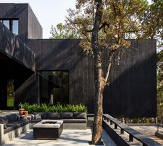 "Miami's Magaldi Studio used charred wood and dark stone to blend this boxy house ""as a shadow in the green surroundings"" of Valle de Bravo, Mexico. Jacuzzi, Outdoor Areas, Indoor Outdoor, Outdoor Living, Parks, Charred Wood, Basement Floor Plans, Dark House, Exposed Concrete"