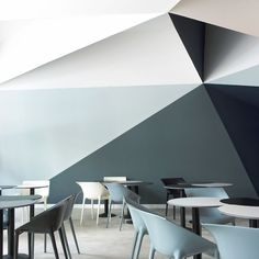 painted detail - creates interesting large geometry with the wall shapes. Minimalist, monochromatic.