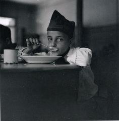 An orphan of war drinking his soup, Gerda Taro