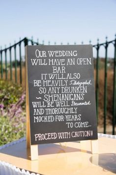"""bar sign: Our wedding will have an open bar. It will also be heavily photographed so any drunken shenanigans will be well documented and thoroughly mocked for years to come... proceed with caution!"""" and more advice in our blog post from interviews with 8 photographers, a MUST-READ for every bride!"""