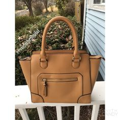 Brown Handbag Beautiful bag in perfect condition, carried only 3-4 times • Hand bag only, no cross body strap attachment • From Forever 21 • 14 inches across, 9.25 inches tall • Super trendy bag! • NO TRADES, NO PAYPAL • Forever 21 Bags Shoulder Bags