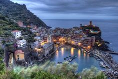 30 Cliff-side Villages Vernazza at Dusk, Cinque Terre, Italy Italy Vacation, Italy Travel, Cinque Terre Italia, Places In Italy, Holiday Places, Tourist Places, Visit Italy, Famous Places, Best Cities