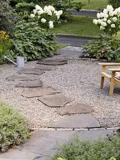 Private and Inviting Front Yard Flagstone stepping-stones leading to the driveway provide an easier-to-navigate surface in a crushed-stone patio. They are also easier to keep clear of snow come winter. Front Yard Landscaping Design, Gravel Garden, Backyard Patio, Small Front Gardens, Patio Garden, Patio Stones, Backyard Garden, Backyard, Front Garden Design