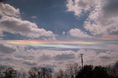 Why would clouds appear to be different colors? The reason here is that ice crystals in distant cirrus clouds are acting like little floating prisms. Sometimes known as a fire rainbow for its flame-like appearance, a circumhorizon arc lies parallel to the horizon.