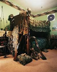 "My little cowboy wants to be a hunter too. Ick! However he said he'll only kill the ""bad animals""! Ha!  Hunting themed bedroom for our little hunter"