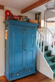 Blue cabinet and stairs