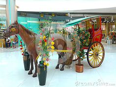 A replica of the calesa, a horse drawn vehicle which originated during the Spanish colonial era. Seen here on display at a mall in Chinatown Manila. Horse Drawn, Spanish Colonial, Manila, Philippines, Vehicle, Fair Grounds, Horses, Display, Animals