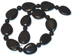 16 in strand of Black onyx puffed teardrop beads  by yadanabeads