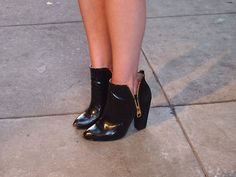 Shiny & Unzipped  Black booties at the No.3/ Refinery 29 party