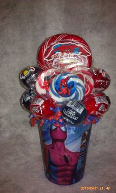 One made to order Spiderman Lollipop Bouquet. A cool unique gift idea for that spiderman fan young and old or great table centerpieces at a Spiderman theme Birthday Party.  **Cup is reusable** **Lollipops are all edible and YUMMY**  ***Don't see a theme your are looking for, message me, I ca...