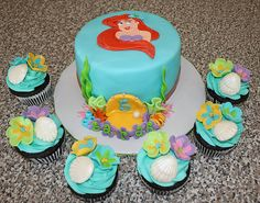 This is a 6 inch round cake with coordinating cupcakes. It was inspired by Maimerbaker's beautiful Ariel cake. The cake is vanilla with a strawberry filling and traditional buttercream and covered in fondant. All decorations are handmade with fondant. Little Mermaid Cupcakes, Little Mermaid Birthday Cake, Disney Cupcakes, Little Mermaid Parties, Mermaid Cakes, The Little Mermaid, Cupcake Cakes, Cupcake Ideas, Fondant Cakes
