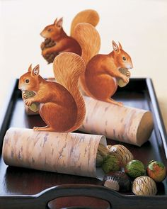 Guests will go nuts over these cute critters. Squirrels perched atop logs filled with foil-wrapped chocolate chestnuts, hazelnuts, and walnuts make sweet seasonal tokens.