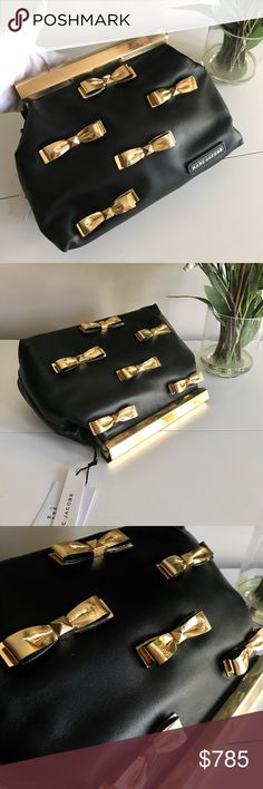 Auth Marc Jacob large evening clutch W Tag $1485 This is a brand new, never used Marc Jacob( this is the highest designer line, not marc by marc jocob ) evening black  leather clutch with gold leather bow accents. This is a store displayed item so there is a few small scratches on exterior leather and  a little blemish on gold- tone metal. The interior is in perfect condition. Please see pictures. Very cute and eye catching piece. Store tag and price tags are on. Retail for $1485 plus tax(…