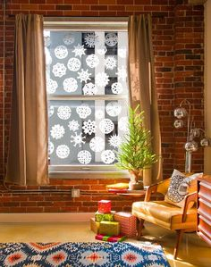 Make a stunning cascade of snowflakes using coffee filters to fancy up your windows this season. DIY instructions included!
