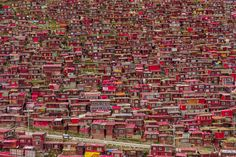 Red homes for Buddhist monks sit on a hill in this National Geographic Your Shot Photo of the Day.