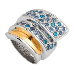 Ring in polished silver and polished gold with stone setting of Aquamarine and Blue Topaz cubic zirconias.