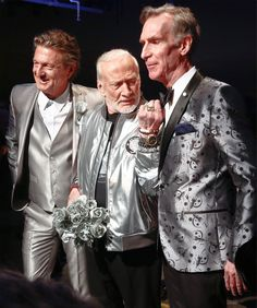 """Fashion designer Nick Graham, left, poses with his guest models, astronaut Buzz Aldrin, center, and Bill Nye, star of TV's """"Science Guy,"""" after unveiling his Mars-themed collection during men's Fashion Week, Tuesday, Jan. 31, 2017, in New York.(AP Photo/Bebeto Matthews)"""
