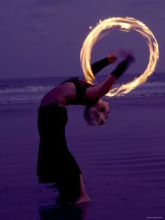 Playing with fire - Fire-eater twirling fire on the beach of Samara Beach, Guanacaste, Costa Rica.
