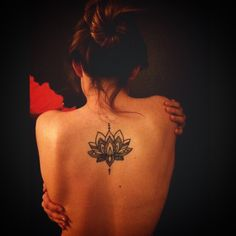 Beautiful lotus back tattoo