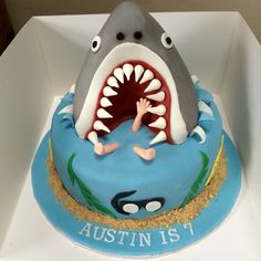 Shark Pinata cake with rice crispy treat topper and body part sweets inside