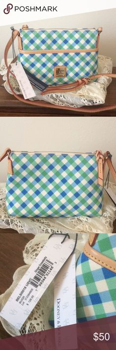 """NWT Dooney & Bourke Crossbody Just in time for spring. A blue and green plaid Dooney & Bourke crossbody. Inside is lined in red with one large slip pocket and one large zip pocket. There is also a front pocket. This bag has tan leather strap and trim. Bag measures 9""""W x 6""""H. Dooney & Bourke Bags Crossbody Bags"""
