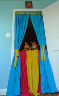 Bold primary colored fabric + tension curtain rods = transformation of a doorway into a stage for your child's imagination.