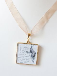 Literary Pendant Inspired by Richard Adam's Watership Down - featuring a lovely illustration of Hazel the chief rabbit of the Watership Down Warren and a quote from the book. Created  by CiarraiStudios, $19.00