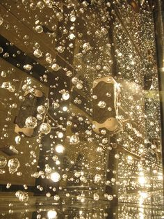 Louis Vuitton Window Display in Macy's - mirrored floor, lights and small faceted baubles catch and throw the light, making it look like champagne bubbles