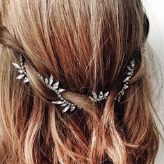 Simple pulled back hair with pretty rhinestone clips.
