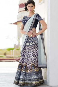 Cream and Blue premium heritage silk semi stitch lehenga with premium heritage silk choli. This lehenga choli is embellished with stone, embroidered and printed.Product are available in 34,36,38,40 sizes. It is perfect for Festival Wear,Party Wear,Eid.   http://www.andaazfashion.co.uk/womens/lehenga-choli/