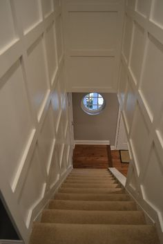 basement stairs looking down. looooooove the paneled look  wainscotting Board and batten of hallway Basement StairsBasement Opening downstairs entry by cutting away wall adding trim to