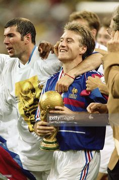 France captain <a gi-track='captionPersonalityLinkClicked' href=/galleries/search?phrase=Didier+Deschamps&family=editorial&specificpeople=213607 ng-click='$event.stopPropagation()'>Didier Deschamps</a> celebrates with the trophy after victory in the World Cup Final against Brazil at the Stade de France in St Denis. France won 3-0.  Mandatory Credit: Ben Radford /Allsport