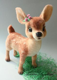 Darling needle felted fawn. This is too cute for words. I love the look of the fawn's face and the little flowers in her hair are a nice touch.