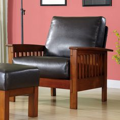 @Overstock - This Patterson Faux Leather and Oak Mission Armchair combines functionality with modern comfort for a twist on mission style. The steam bent arms, bright oak finish and oversized inner spring cushions finish this contemporary chair.http://www.overstock.com/Home-Garden/Patterson-Faux-Leather-and-Oak-Mission-Armchair/4747395/product.html?CID=214117 $237.99