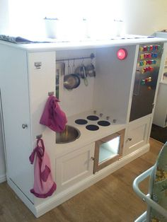 My Frugal Family: Kids kitchen out of entertainment center. Love the idea of using chalkboard paint on the fridge door. Old Entertainment Centers, Entertainment Center Decor, Entertainment System, Diy Play Kitchen, Play Kitchens, Kid Kitchen, Diy Karton, Frugal Family, Family Kids