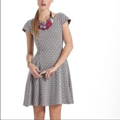 Anthropologie Maeve diamond pattern dress Good condition, has one discolored food stain on skirt that could be removed, I just haven't had it dry cleaned. Black and white jacquard pattern with swingy skirt, cap sleeves, pull on pattern, thicker knit, fully lined Anthropologie Dresses