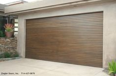 , Brown Modern Garage Door With Bedboard Style Also Gray Wall And Concrete Ground Color Also Beautiful Aloe Vera Plant: Exciting Modern Garage Door for Your Home