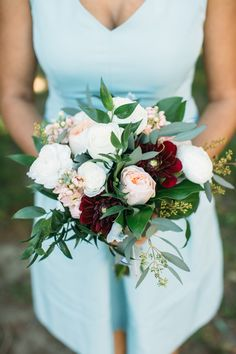 white and peach bouquet with burgundy - photo by Brae Howard Photography http://ruffledblog.com/sophistication-and-elegance-at-horticulture-center #bouquets #weddingbouquet