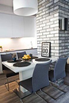 Modern dining room Simple recipe for a balanced and practical interior. Modern white table, contrasting graphite upholstery of the chairs. Modern detailes. Nowoczesna jadalnia. Białe proste szafki, błyszczące fronty, prosty biały stół. Nowoczesne dodatki.  #white #grey #dining room #modern #apartment #ideas #design #remodeling #interiors #open #small #makeover #jadalnia #nowoczesna #biała #szara #dekoracje #inspiracje #mała #stół #z salonem #krzesła #styl #inspiracje
