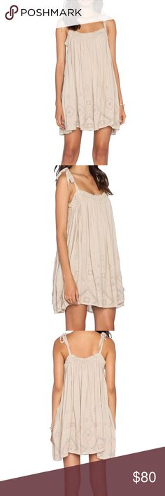 🎉HP🎉NWOT-FREE PEOPLE  Summer Sun Tunic NWOT- Super adorable Free People Baby Doll Dress. Features embroidered hem line and shoulder strap ties. Made of 55%Viscose and 45% cotton. Hand wash cold. Free People Style number OB396463. Please no holds, trades, or PP! Thank you for taking a look😊 Free People Dresses Mini