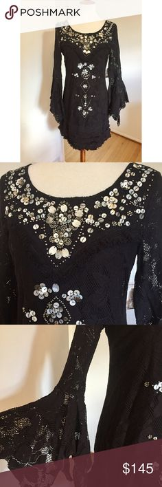 """Free People • Shell Game Dress Free People Party Shell Game in Black. GORGEOUSLY INTRICATE ❤️ Boatneck, scoop back, long flounce sleeves, front embellishment, allover lace design, front beaded accents, back zipper closure, fringe trim, fully lined. Ready for the holidays! You won't even need any jewelry with this dress.  Size 4: 18"""" underarm span and 34"""" long.  Size 6: 19"""" underarm span and 34"""" long. Free People Dresses"""