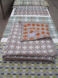 Eleanor Pritchard http://www.cadesign.ie/furniture/eleanor-pritchard-blankets/light-grey-and-orange-line-blanket/