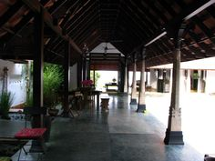 verandah with stone pillars and a lily pool