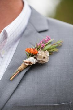 Beach wedding boutonnière with a tiny shell