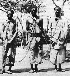 Slaves chained together. This was done so they couldn't run.