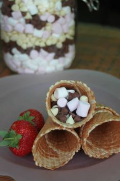 Fill waffle cones with mini marshmallows and chocolate chips (add chopped fruit if desired) wrap in foil and put over hot coals on a BBQ. Shut the lid and leave for around 5 mins to melt. Waffle Cones, Mini Marshmallows, Chocolate Chips, Waffles, Main Dishes, Bbq, Fill, Camping, Fruit