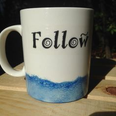 What teacher or parent can live without coffee? Fill up on your caffeine while being reminded why it is you do what you do -- from the inspirational words of Maria Montessori.  Quote reads: Follow the child. Maria Montessori.  11oz white ceramic mug with blue band at bottom in watercolor style. Hand wash only.