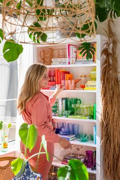 A Colorful, Maximalist Apartment Has 55 Plants and a 'Sexy Coffin-Style' Bedroom - Eclectic Home Decor Colored Glass Bottles, Vintage Bar Carts, Colorful Apartment, Custom Neon Signs, Target Rug, All Of The Lights, Pink Table, Boho Living Room, Gold Walls