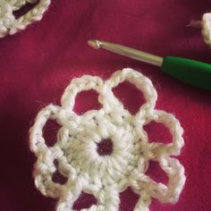 Vortex Garden / Frozen Inspired Crochet Afghan – Rounds 1 and 2 of the large snowflake motif. Red Heart yarn - white Sparkle Soft.